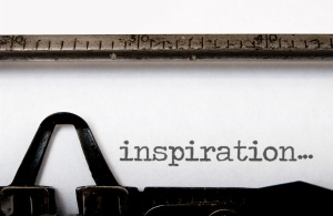 The word inspiration written on a vintage typewriter